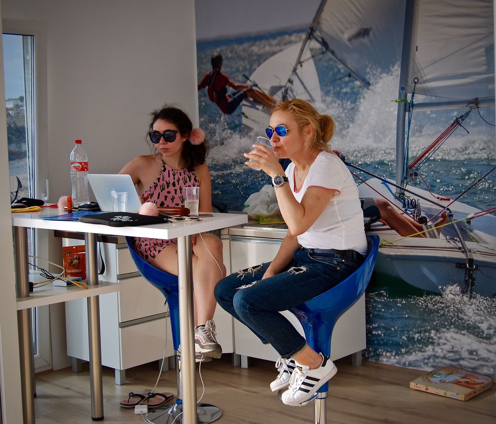 friendly staff working in the office in Amarilla Sailing Club in Tenerife