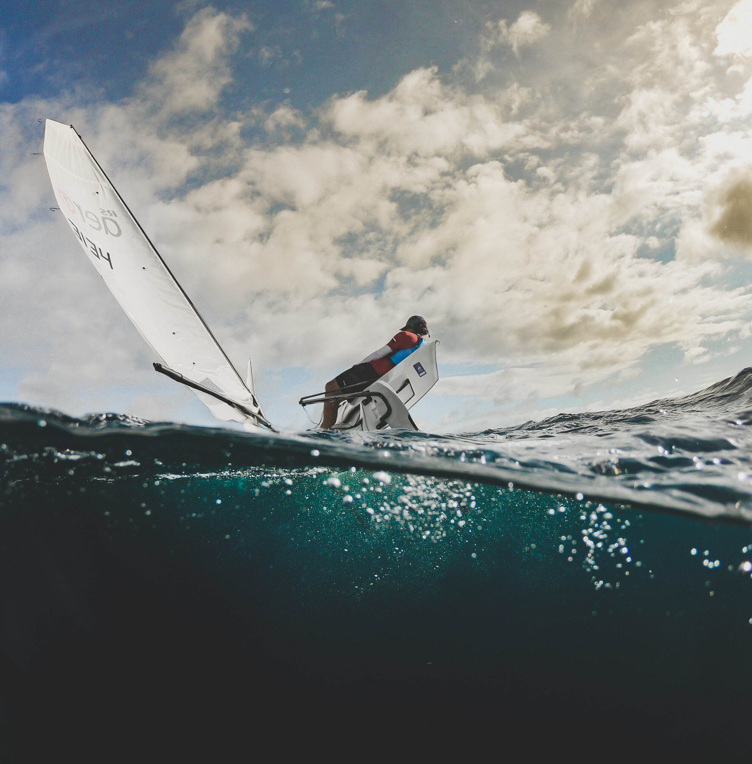 a sailor sailing rs aero in the winter in tenerife