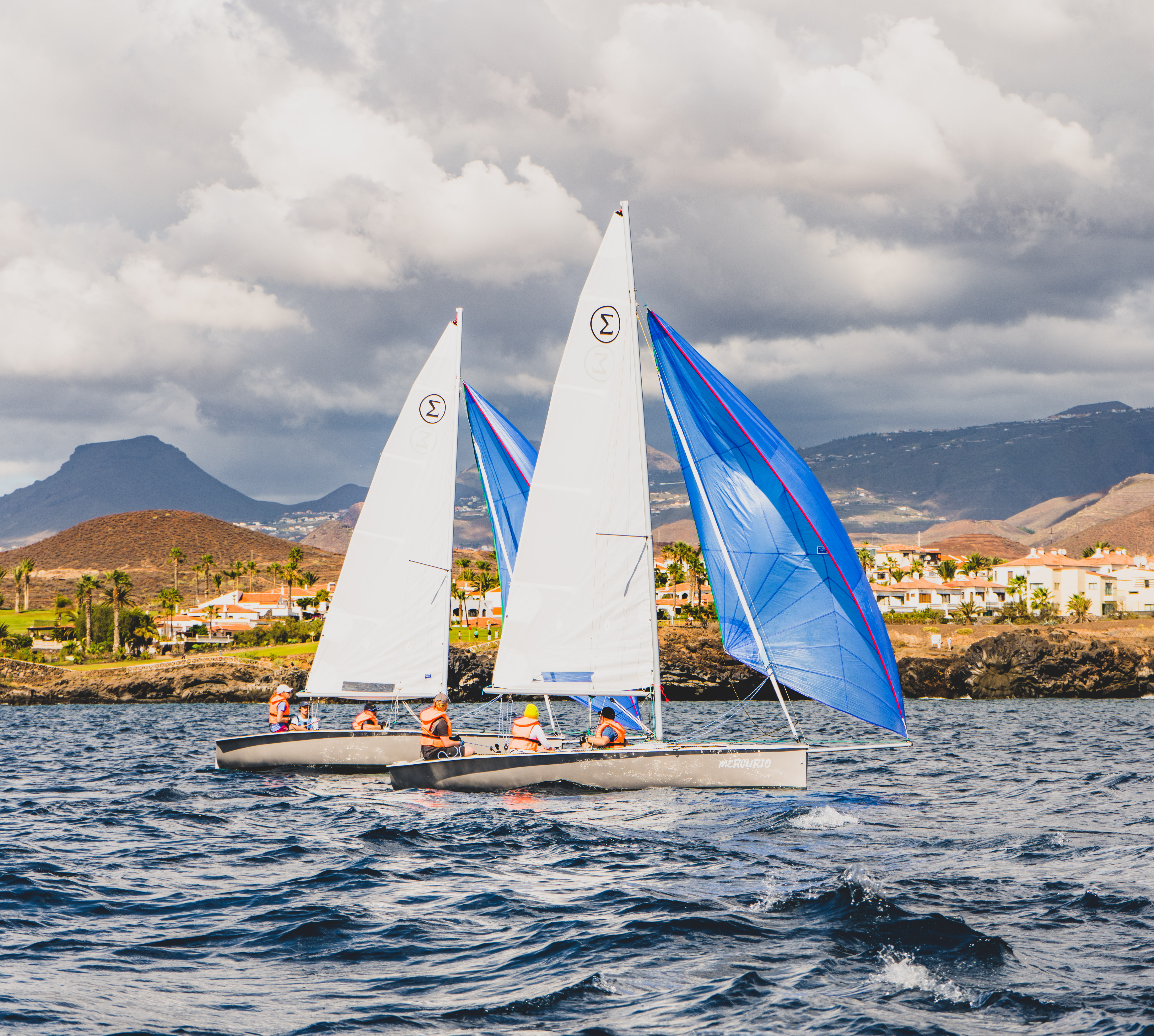 two sigma dinghies sailing with gennakers in Tenerife